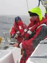 Taking in Sail in heavy Rain.