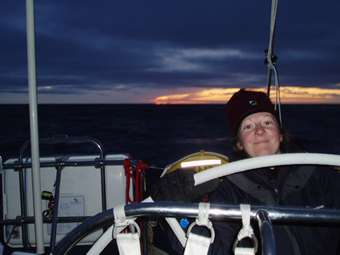 Louise at the helm at sunset