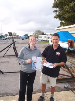 Andy and Louise with proud smiles after receiving their Competent Crew certificates