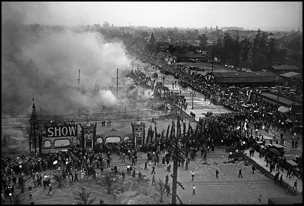 Mar. 5, 1929:  Overhead view of crowds surrounding the Los Angeles Auto Show grounds as smoke rises from the remains of the tents, 1929