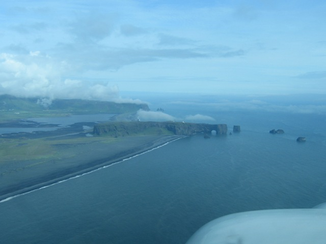 Rocks near Vik. Somebody flew through the hole in a light aircraft!